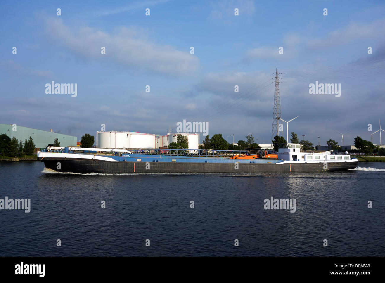 Cargo inland vessel sailing in the port of Ghent, East Flanders, Belgium - Stock Image