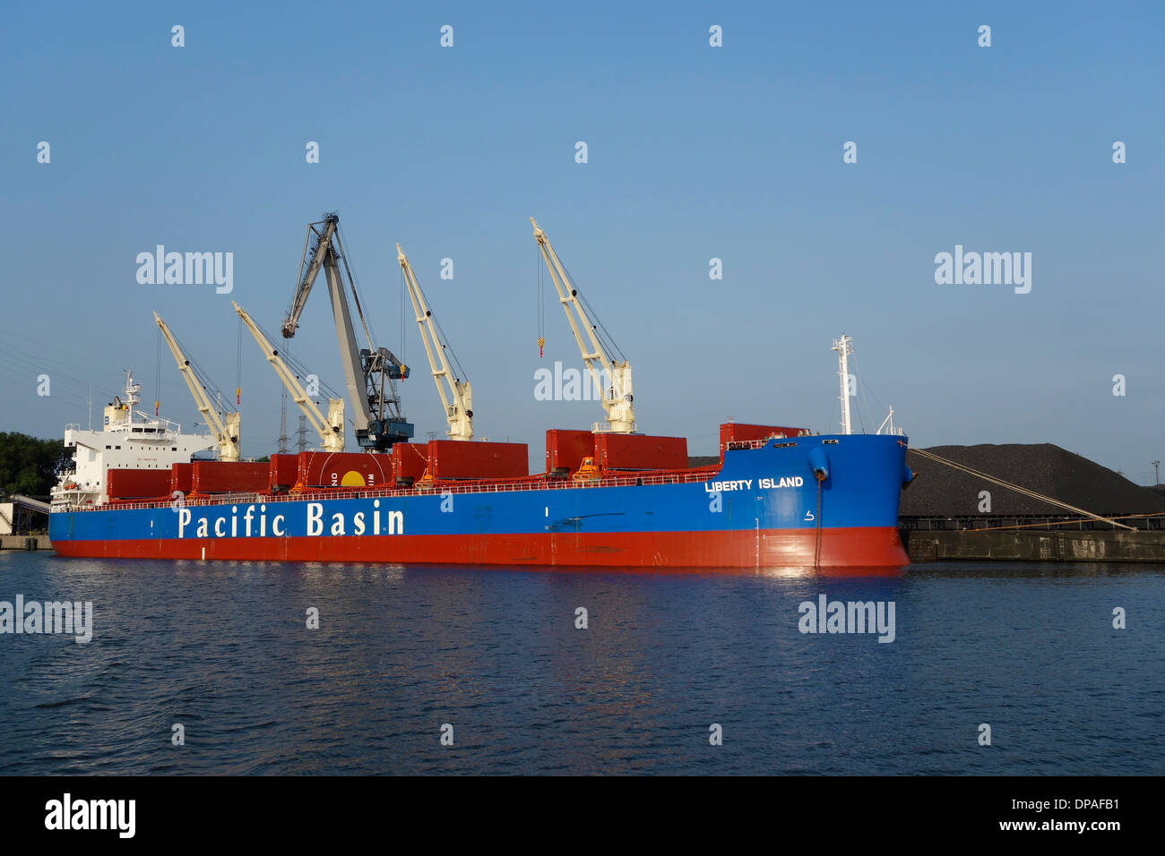 Pacific Basin bulk carrier docked at SEA-invest / Ghent Coal Terminal at the port of Ghent, East Flanders, Belgium - Stock Image