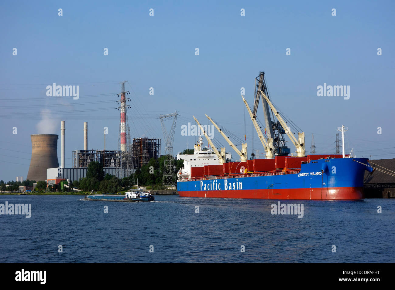 Electrabel power station and bulk carrier docked at SEA-invest / Ghent Coal Terminal at Ghent seaport, East Flanders, - Stock Image