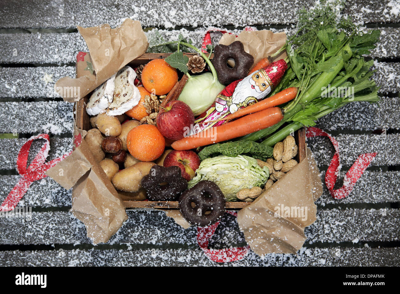 Unwrapped box of savoury and sweet christmas food - Stock Image
