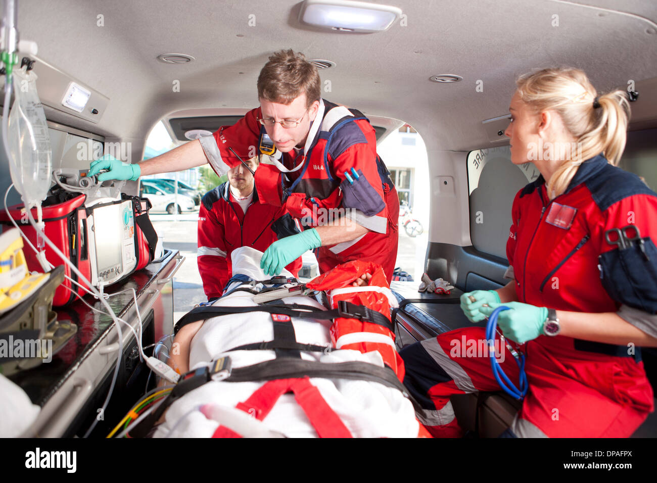 Paramedics checking patient in ambulance Stock Photo