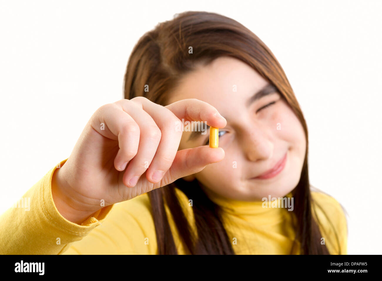 young girl holding and analizing capsule - Stock Image