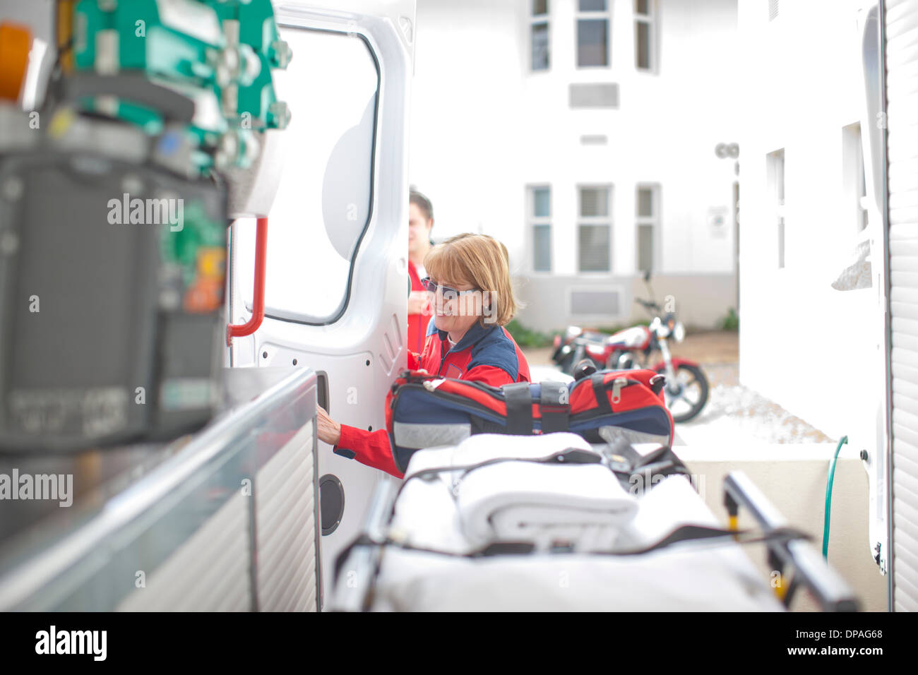 Paramedic opening ambulance door - Stock Image