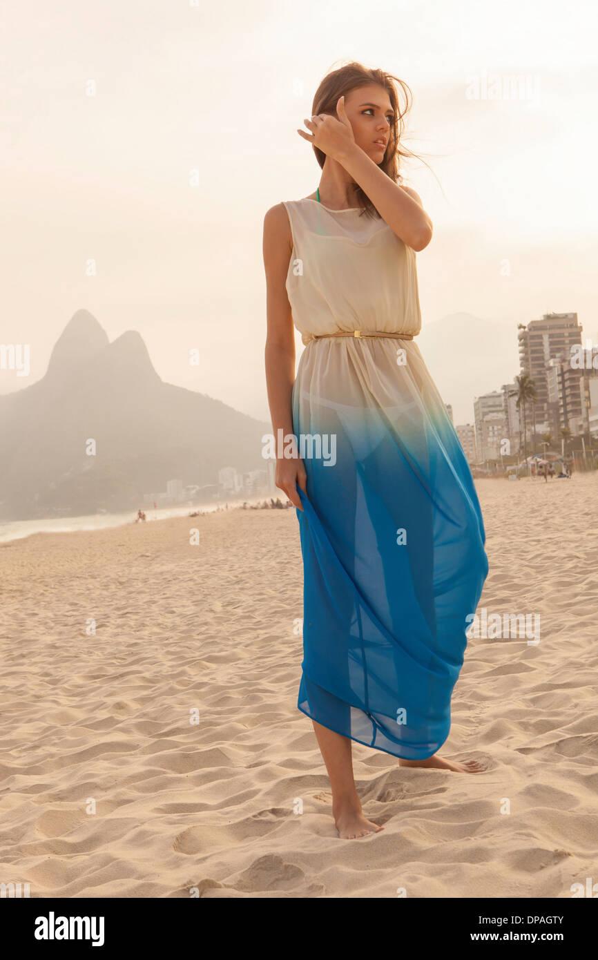Portrait of young woman on Ipanema Beach, Rio de Janeiro, Brazil - Stock Image