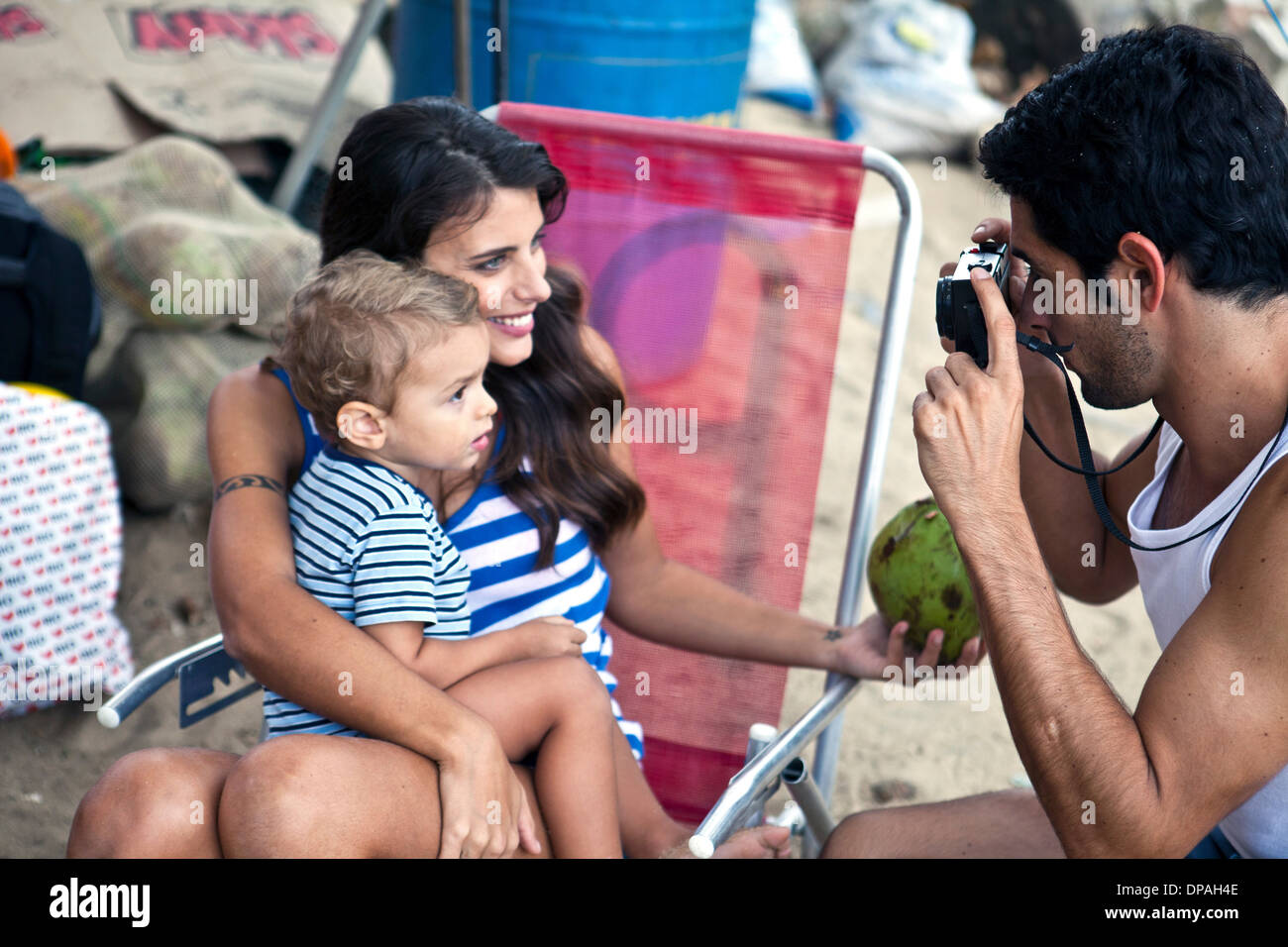Mother and son, father taking photograph - Stock Image