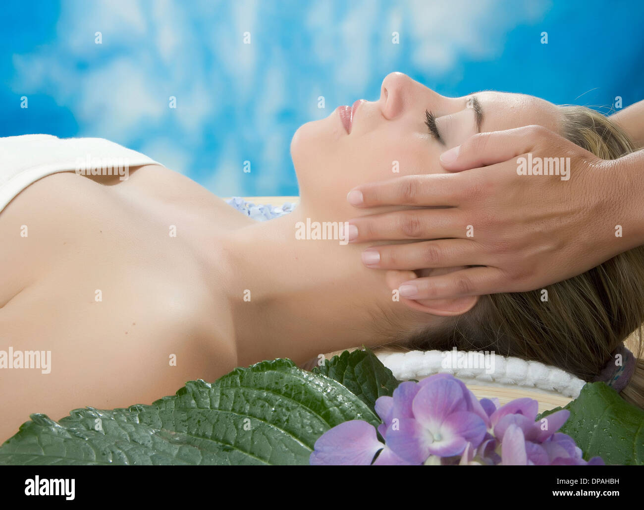 Side view of woman having head massage - Stock Image