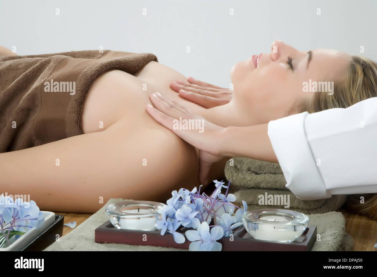 Woman having shoulder massage at spa - Stock Image