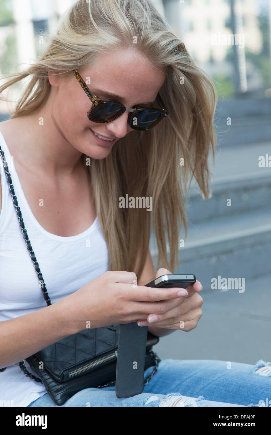 Young woman using cellular phone Stock Photo