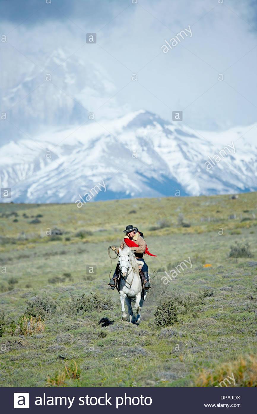 Man riding horse, Patagonia, Chile - Stock Image