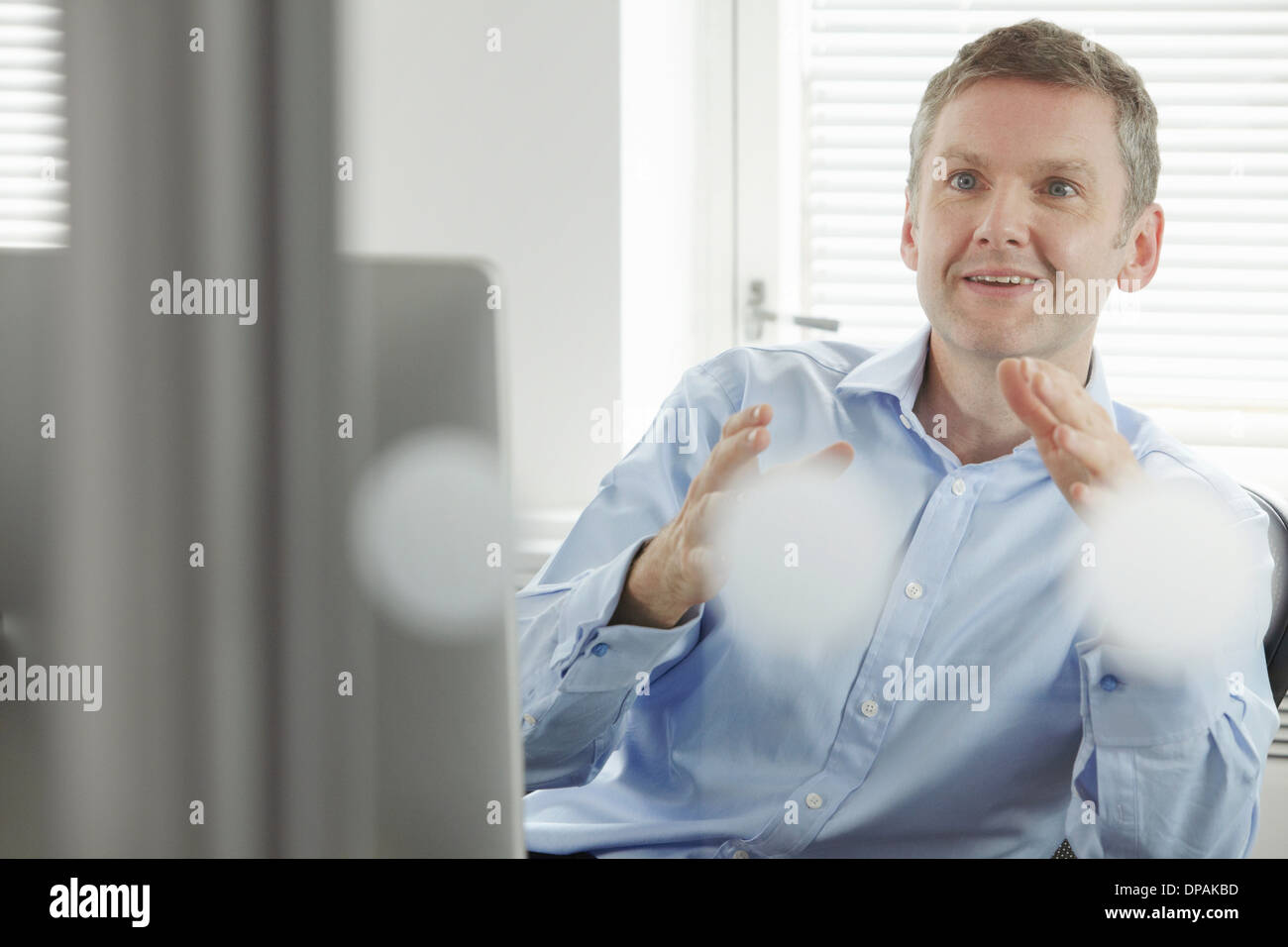 Mature businessman gesturing - Stock Image