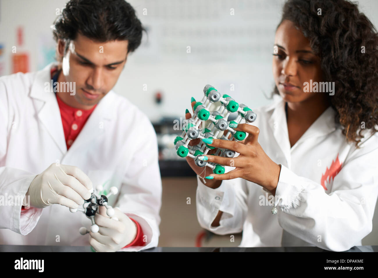 College students holding molecular models - Stock Image