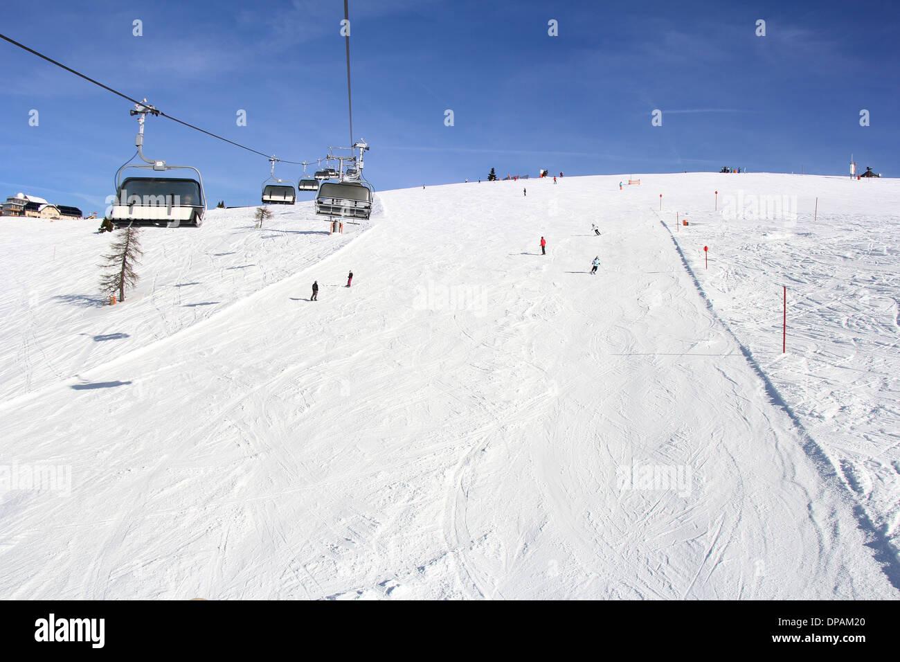 Ski lift and skiers on the Mountain ski resort Gerlitzen, Austria Stock Photo