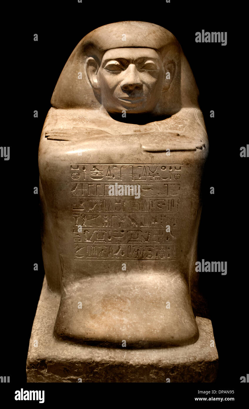 crouching man (statue cubic registered) offering the king the benefit of an employee appointed  Abydos Egypt 1790-1700 BC - Stock Image