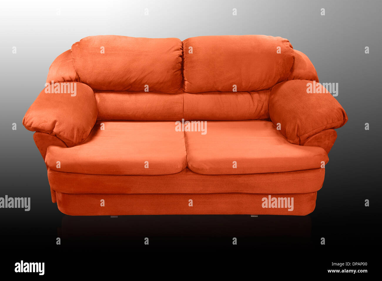 Isolated red sofa on white background. Red couch proper for furniture design. - Stock Image