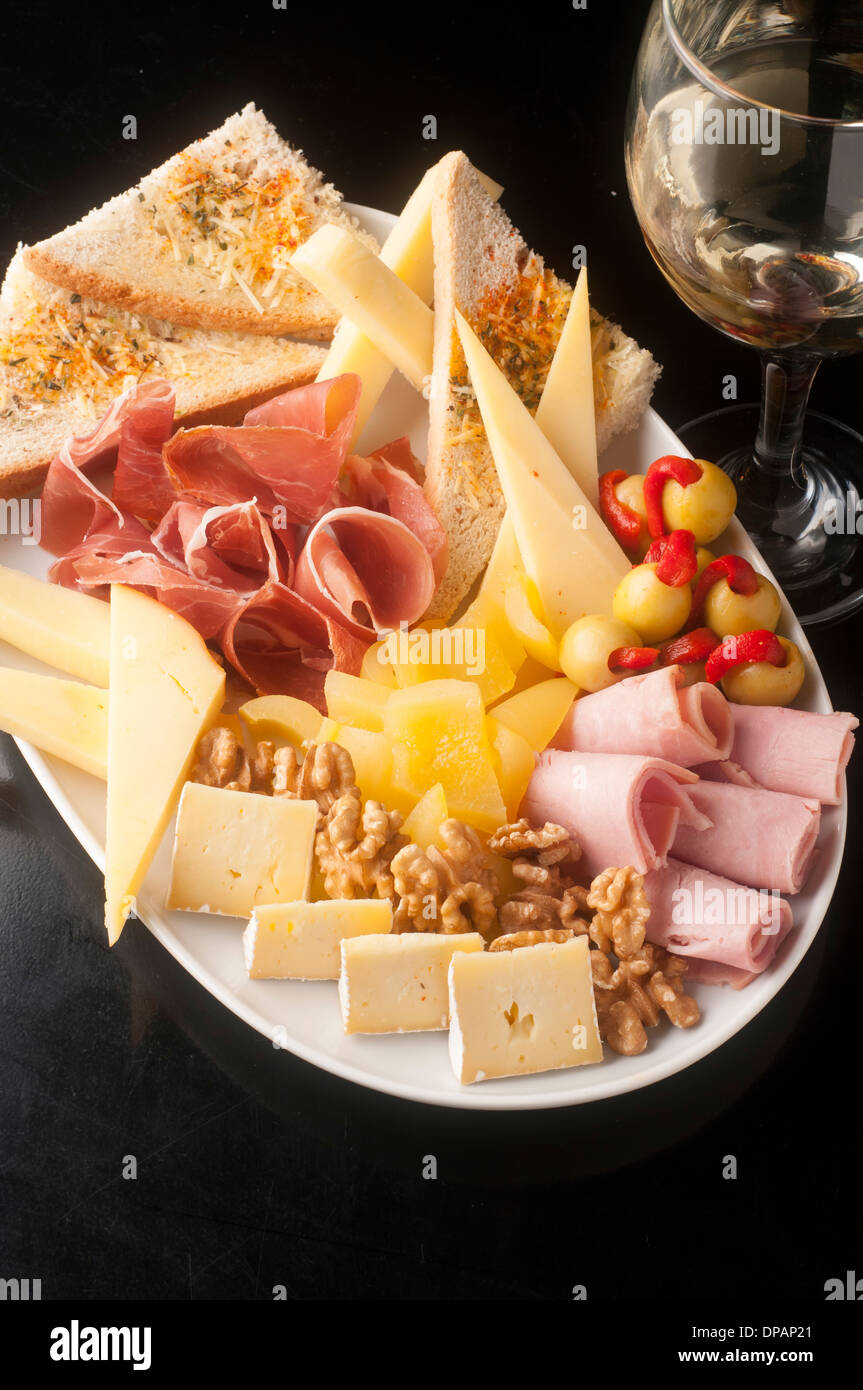 tasty and generous cheese platter to share - Stock Image