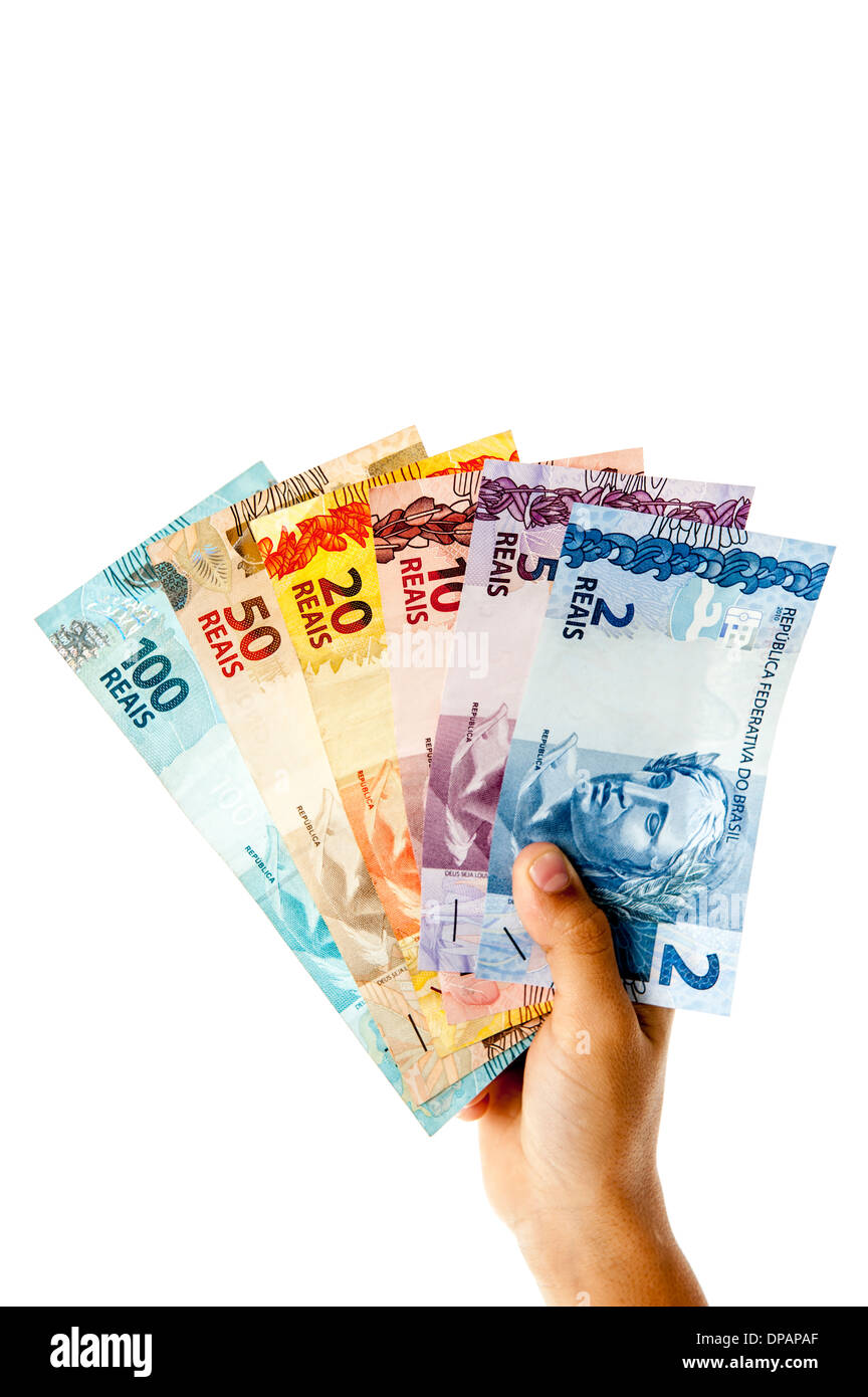 Hand showing Brazilian currencies, 2 to 100 BRL . - Stock Image