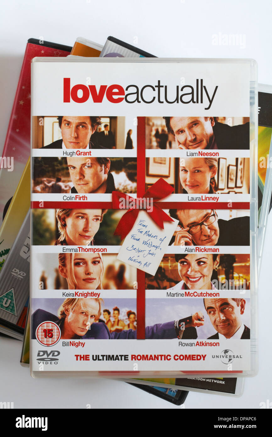 pile of DVDs with love actually the ultimate romantic comedy DVD on top - Stock Image