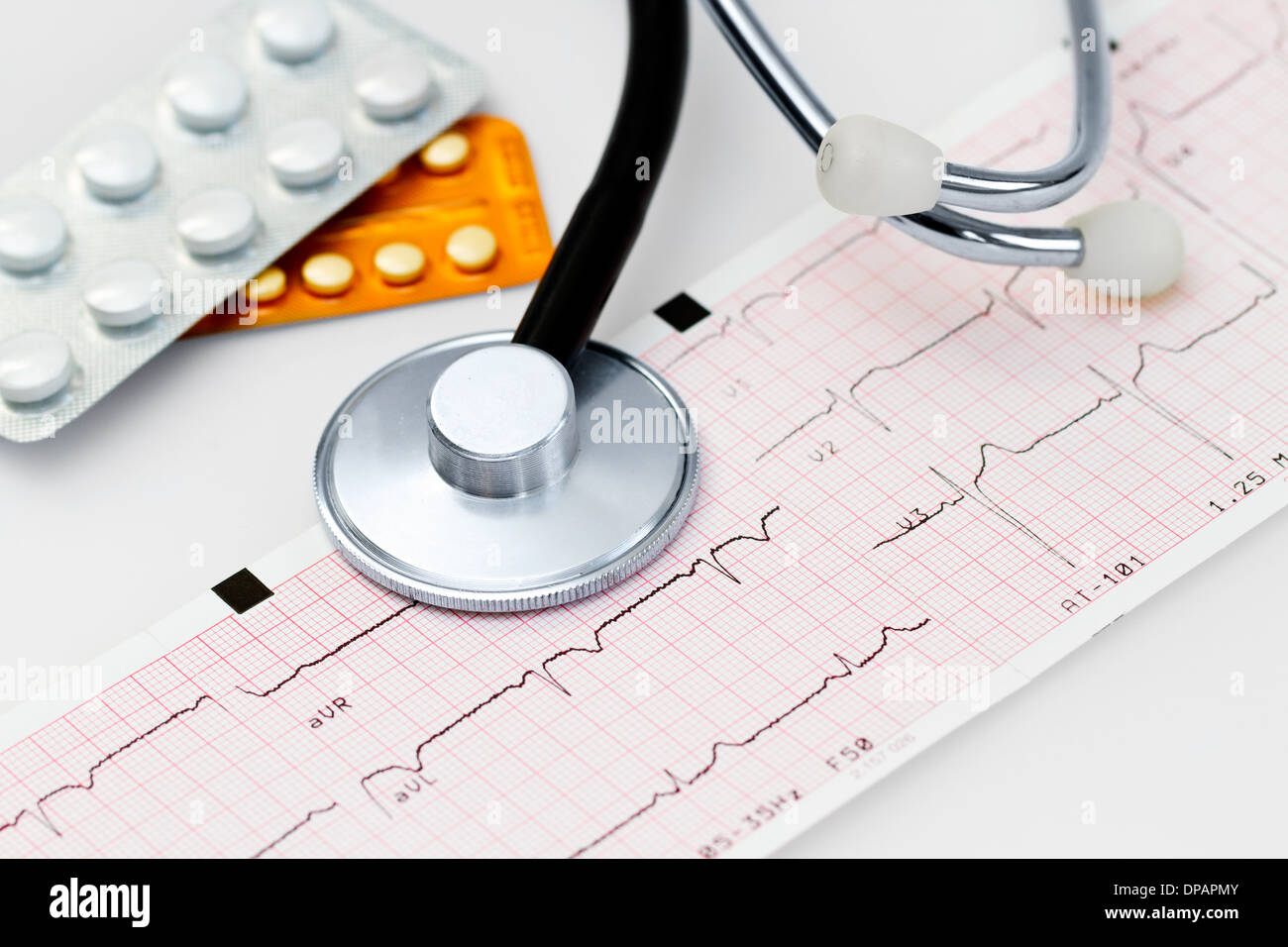 Cardiogram with stethoscope and cardio pills - Stock Image