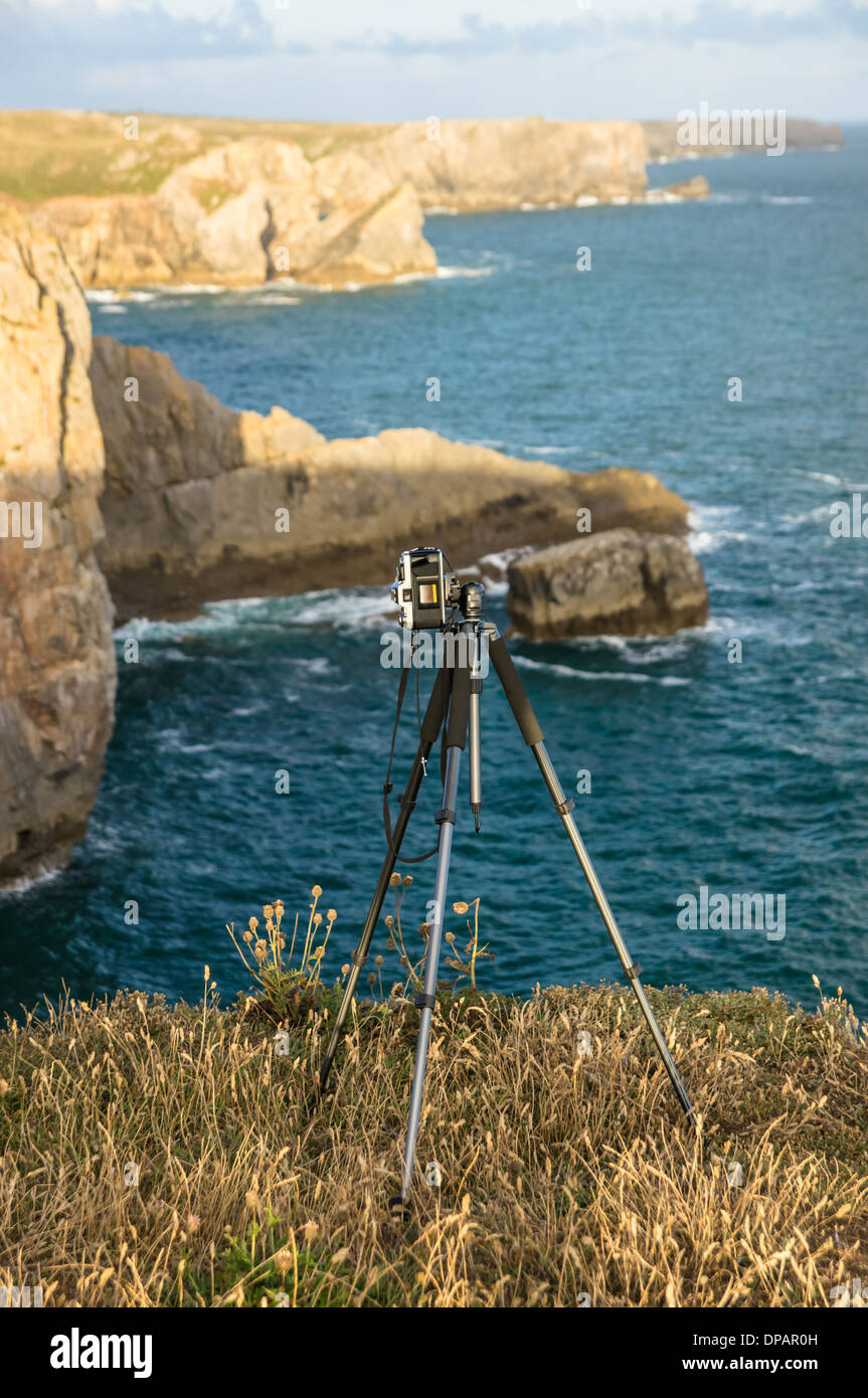 Camera on the tripod on rocky cliffs in Pembrokeshire Coast National Park Wales United Kingdom UK - Stock Image