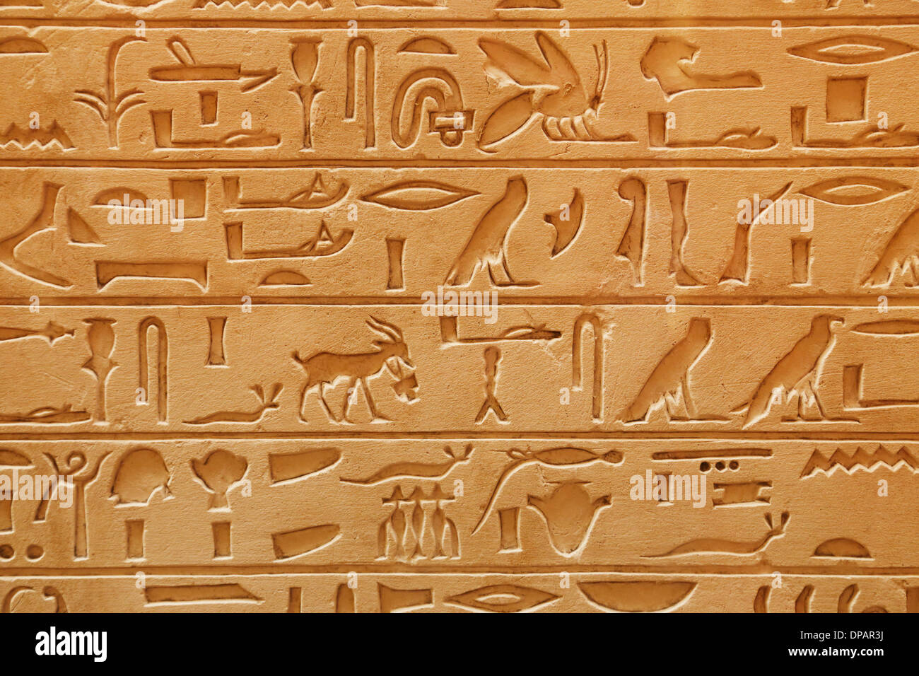 An old Egyptian pictorial writing on a sandstone - Stock Image