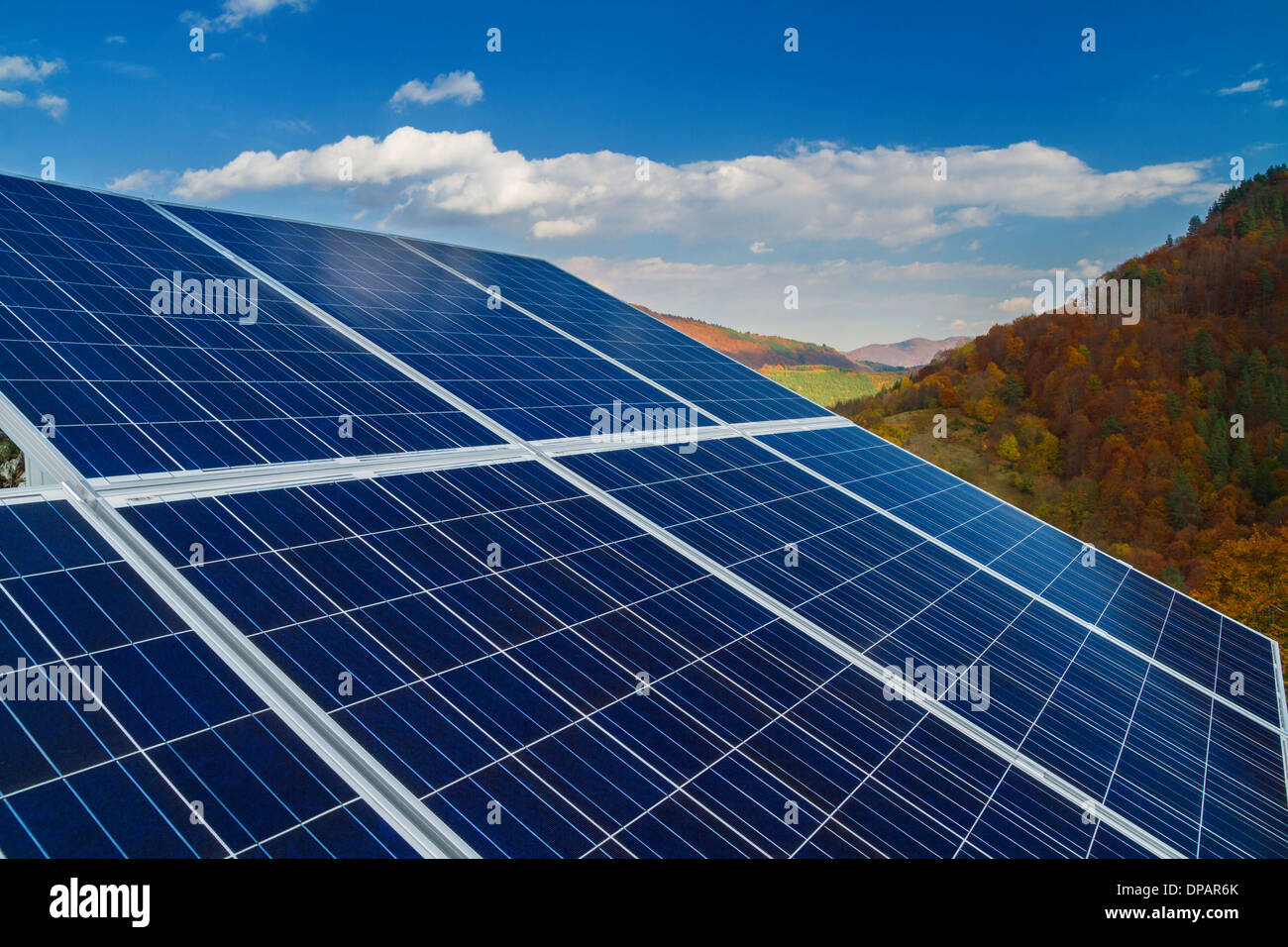 Solar panels installation with blue sky - Stock Image