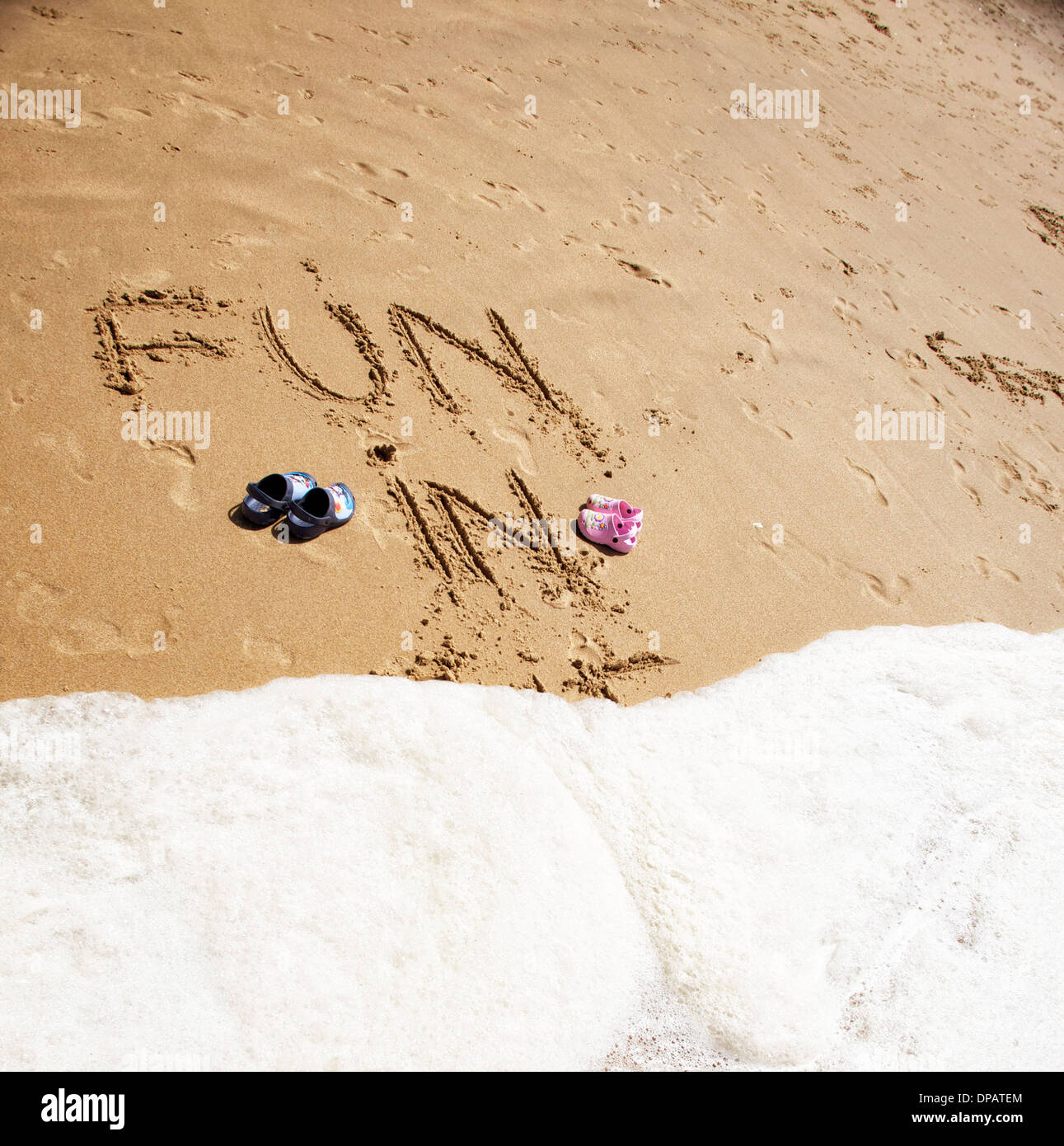 Messages and words written in the sand on a beach. Topical for travel agents and holidays - Stock Image