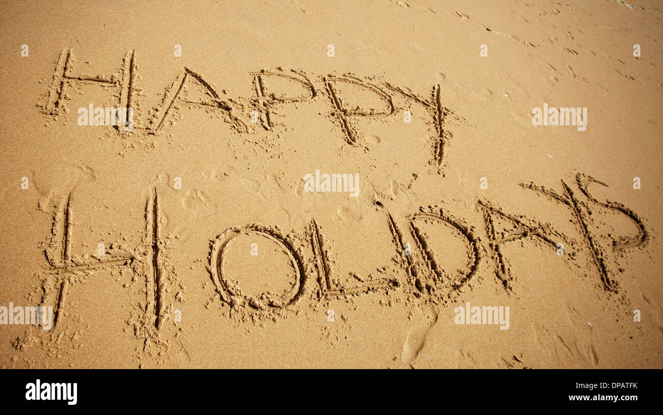 Message or greeting written in sand at the beach - Stock Image