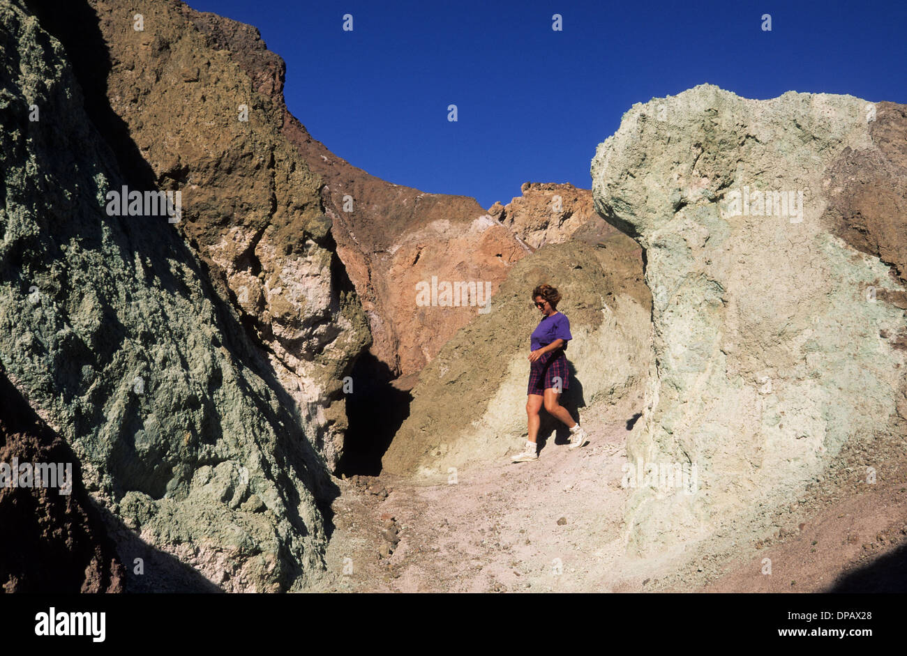 Elk248-1468 California, Death Valley National Park, Artists Drive, Artists Palette with hiker - Stock Image
