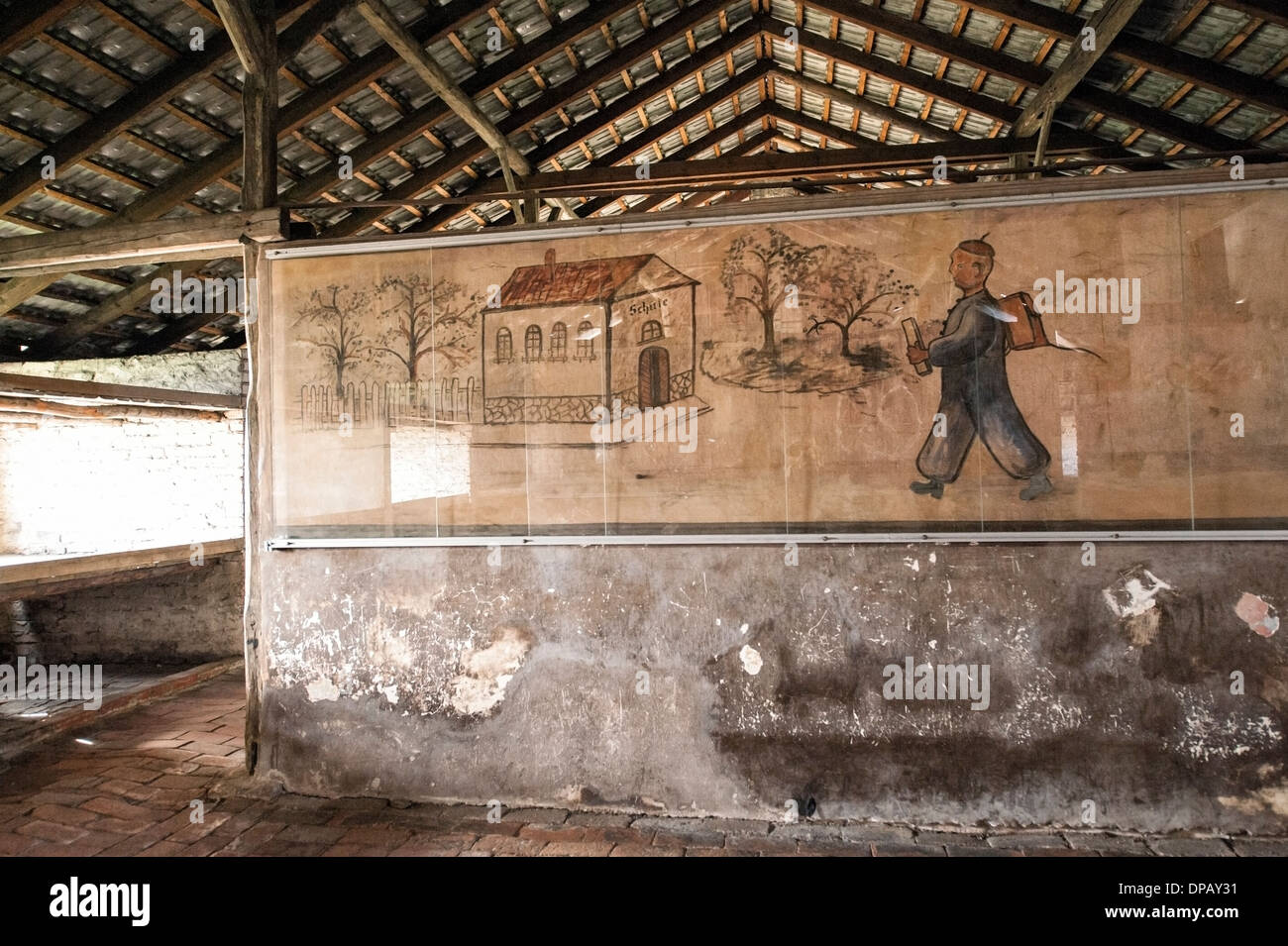 Children's drawing inside barracks that housed victims, Auschwitz II Birkenau concentration camp, Oswiecim, Poland, Europe - Stock Image