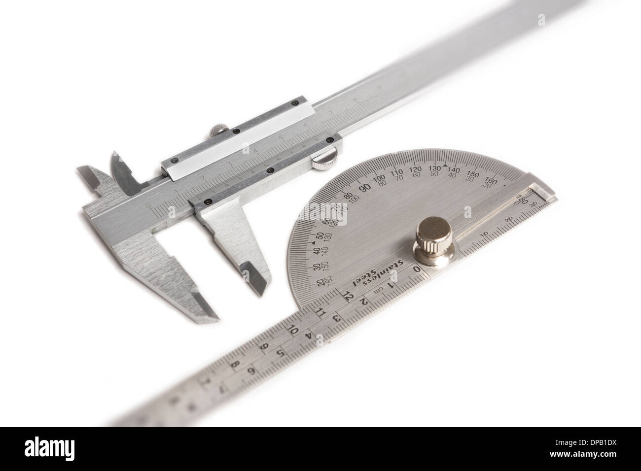 Vernier caliper and protractor isolated on white - Stock Image