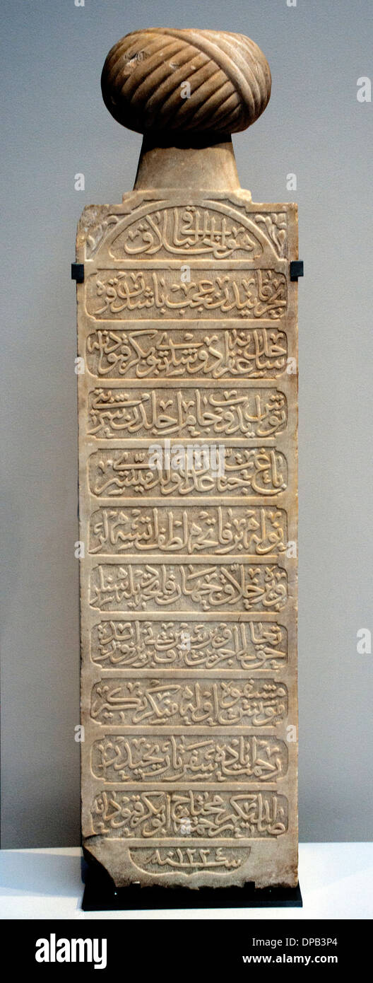 funerary stele -  stela  crowned with a turban and registered in Ottoman (Osmanli Old Turkish Arabic letters) Turkey 1809 - Stock Image