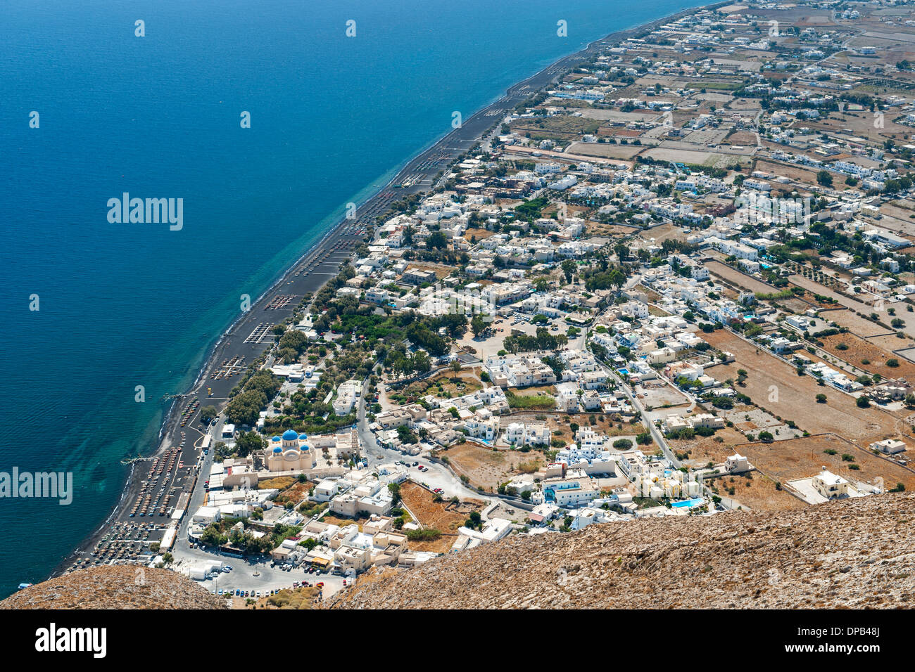 View from Messavouno mountain onto the beach and village of Perissa and the area of Perivolos on the Greek island of Santorini. - Stock Image