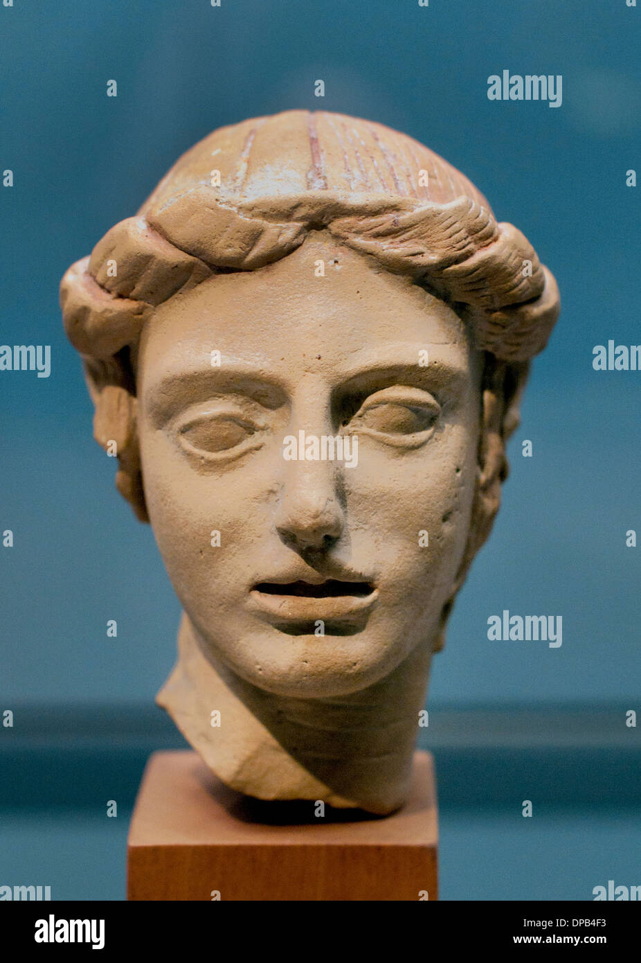 Apollo the eternally young god Terracotta from Taranto 500-400 BC Plate Greek Greece - Stock Image