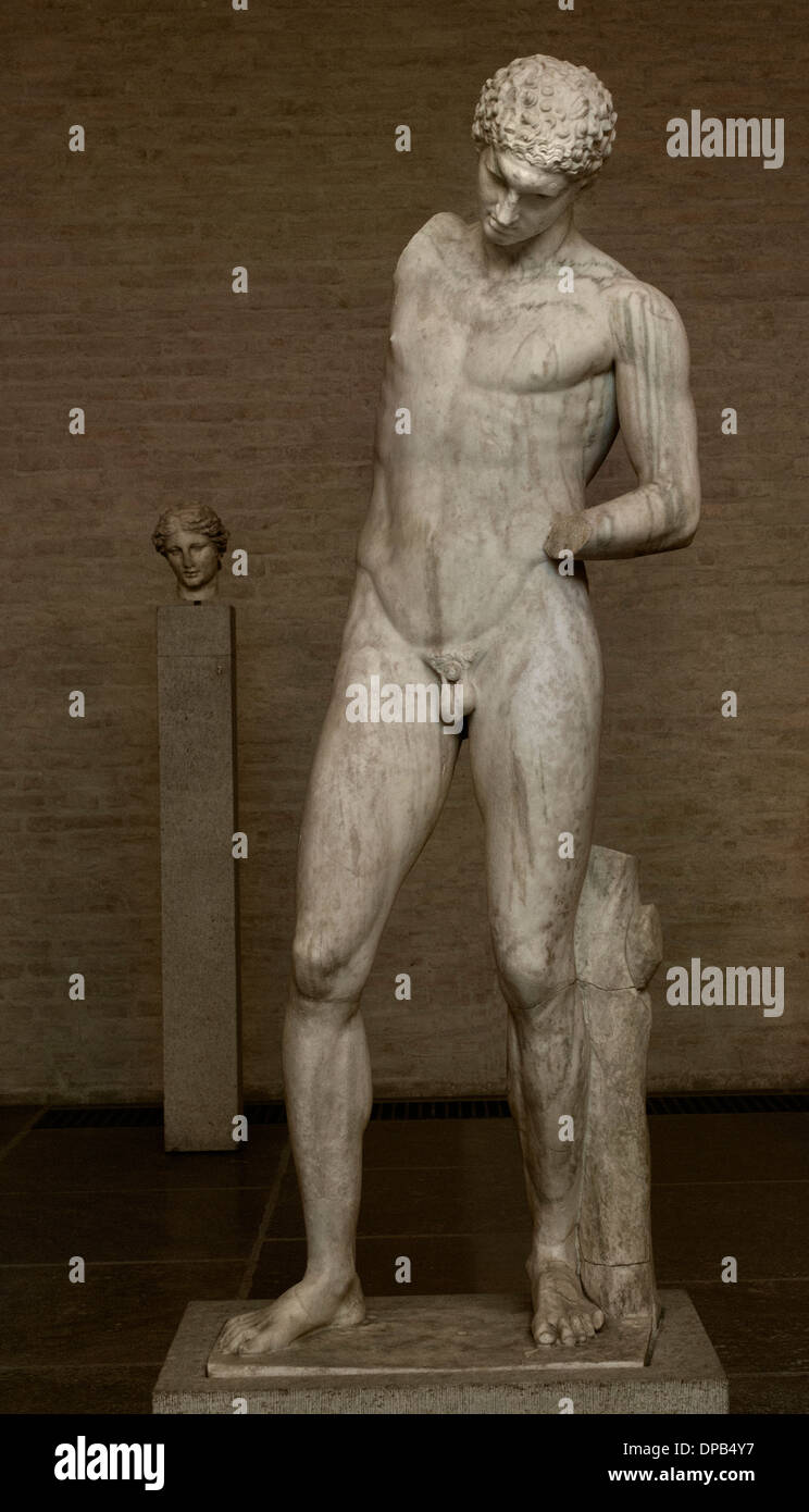 Athlete cleaning himself after a victorious contest holds a vase in his raised right hand and pours oil in his left hand 350 BC - Stock Image