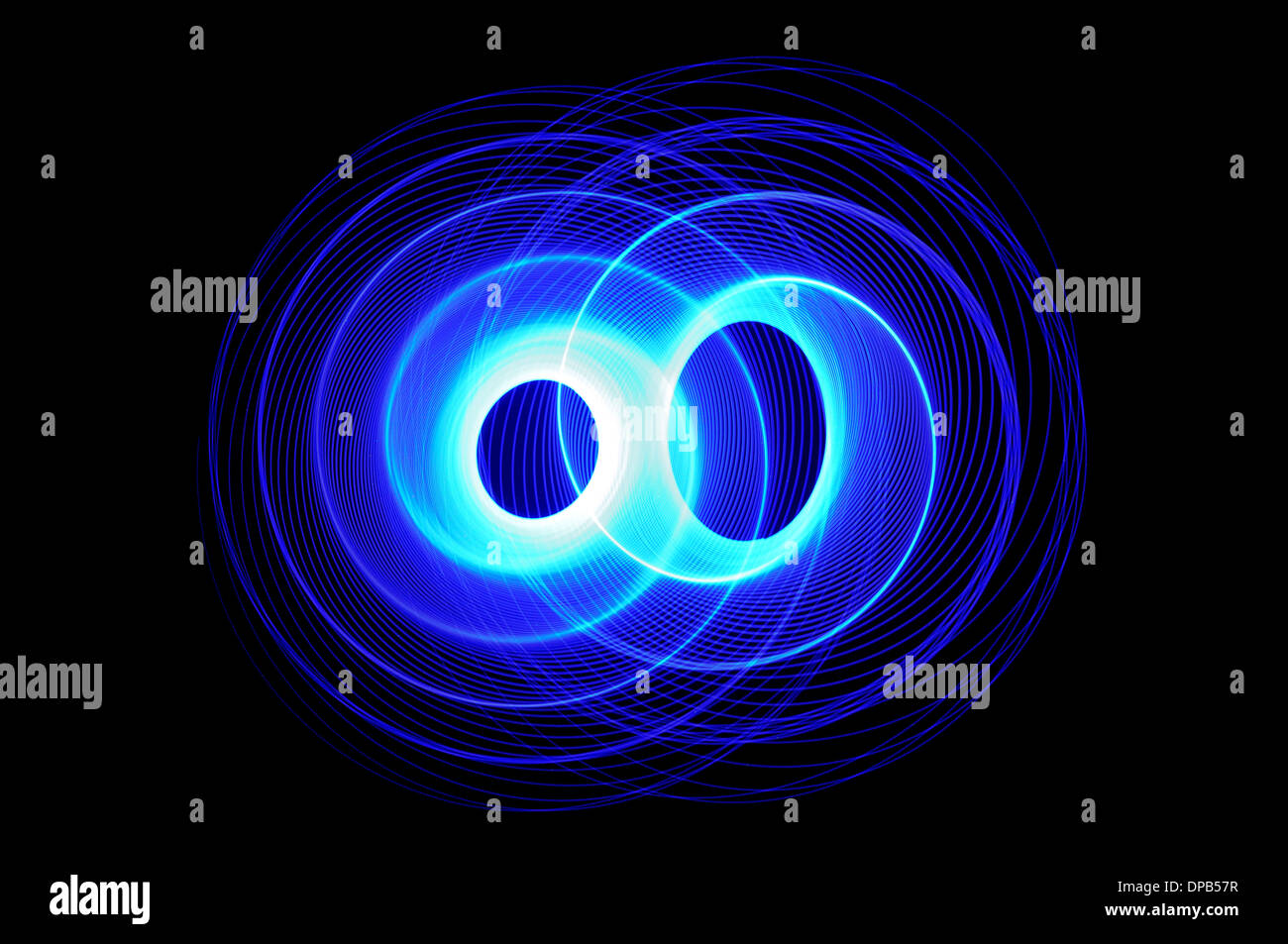 Overlapping long exposure abstract blue light trail spirals - Stock Image