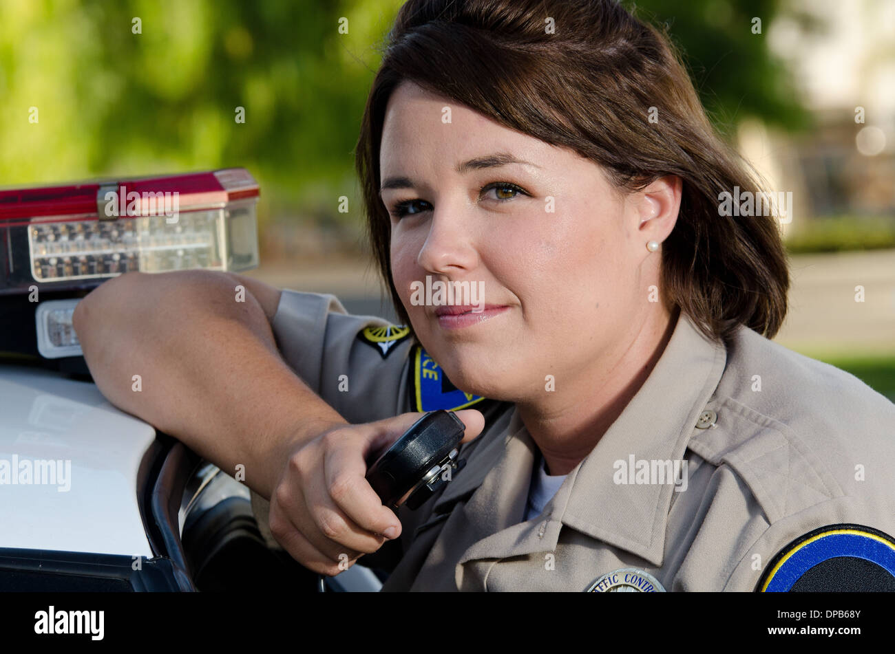 a female police officer holds the radio as she's about to