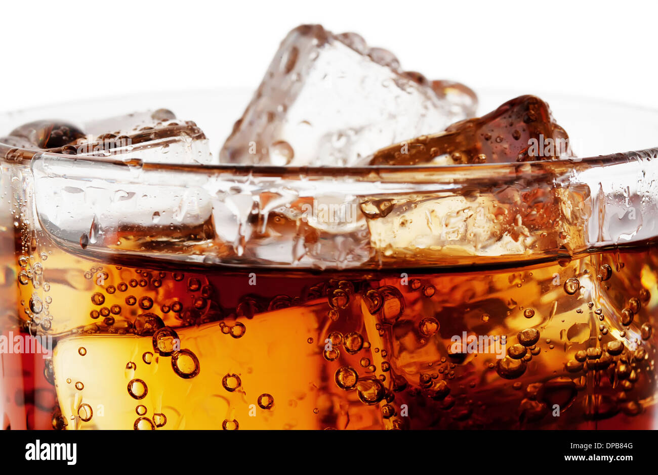 Fragment of glass cola with ice isolated on white background - Stock Image