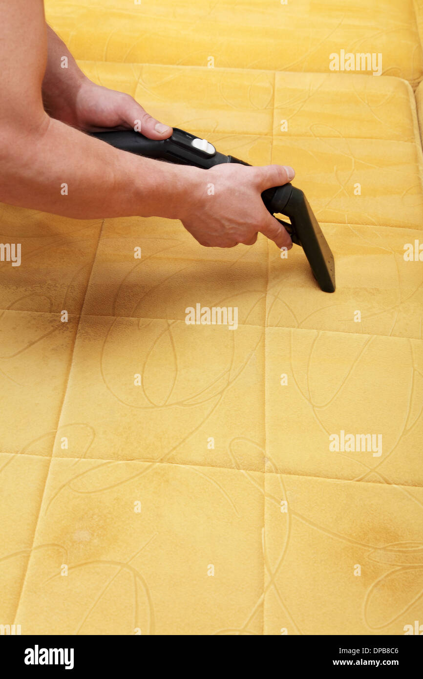 Professional cleaning of the upholstery on a sofa - Stock Image