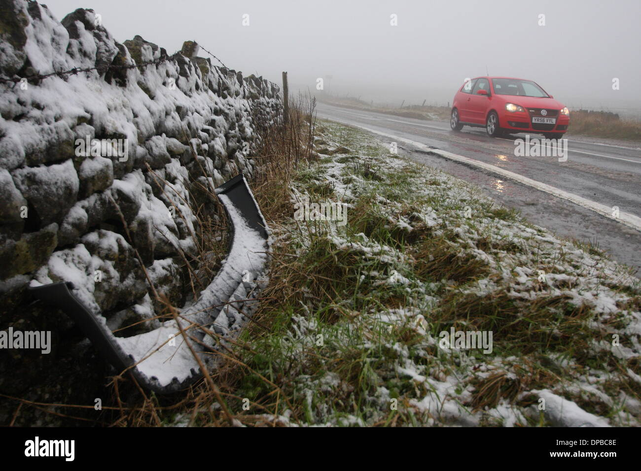 Peak District, Derbyshire, UK. 11th January 2014. 11 Jan 2014  Wintry conditions on the A6187 near Castleton made for extra tricky driving conditions after overnight snowfall hit stretches of high ground iin Derbyshire's Peak District. Credit:  Matthew Taylor/Alamy Live News - Stock Image