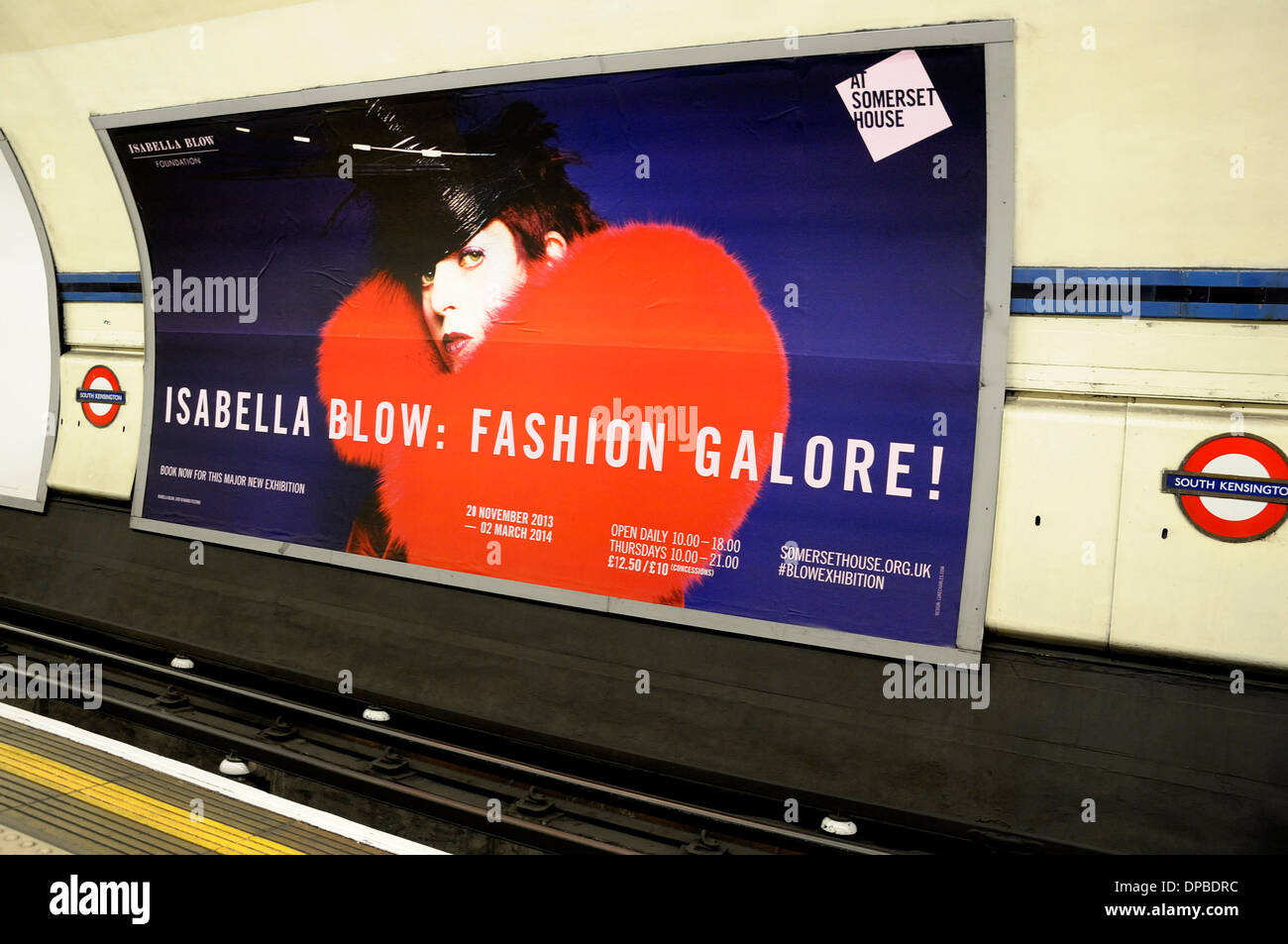 London, England, UK. Advert in South Kensington underground station for fashion exhibition at Somerset House - Stock Image