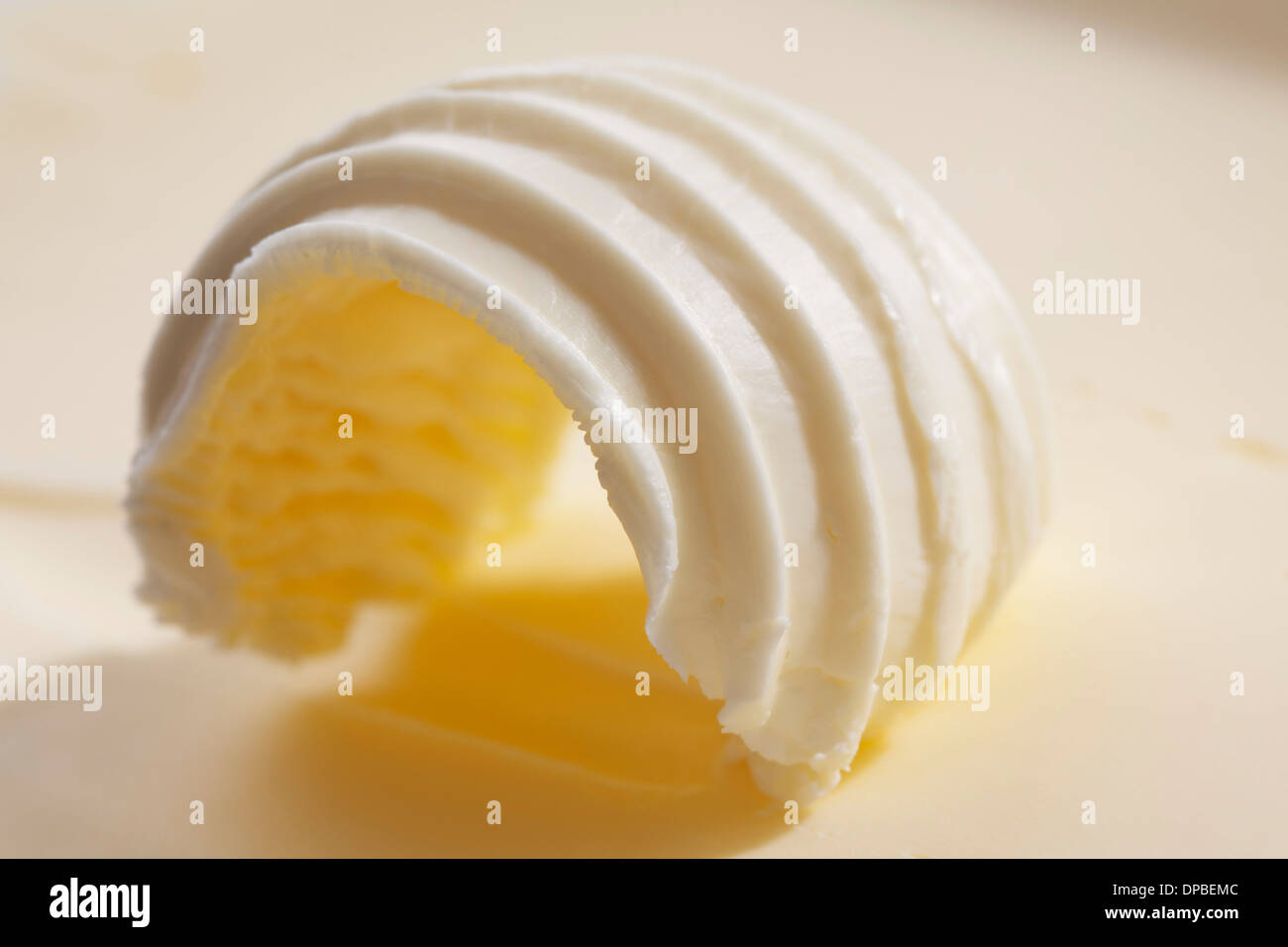 Curl of butter, close up - Stock Image