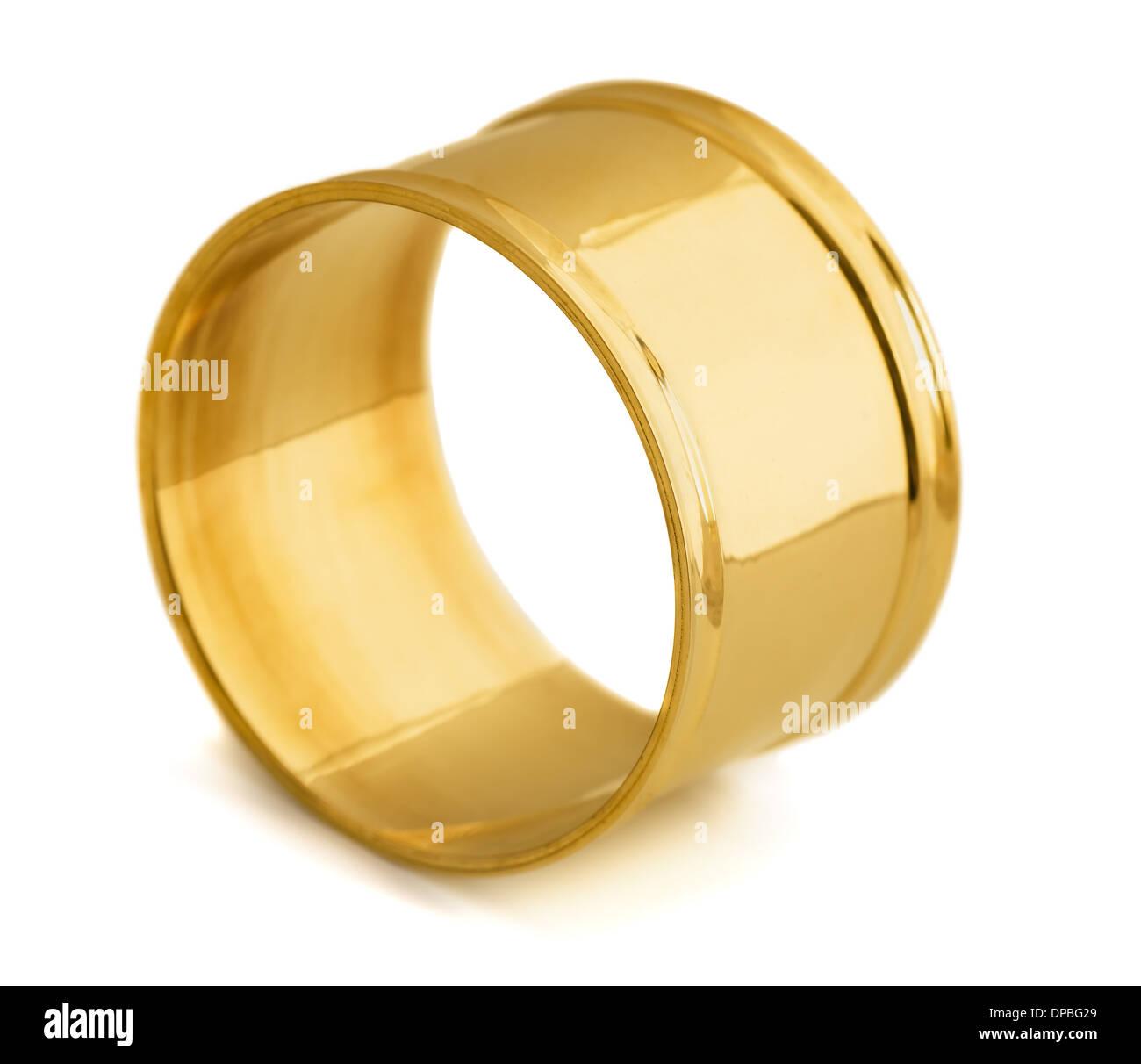 Empty golden napkin ring isolated on white - Stock Image