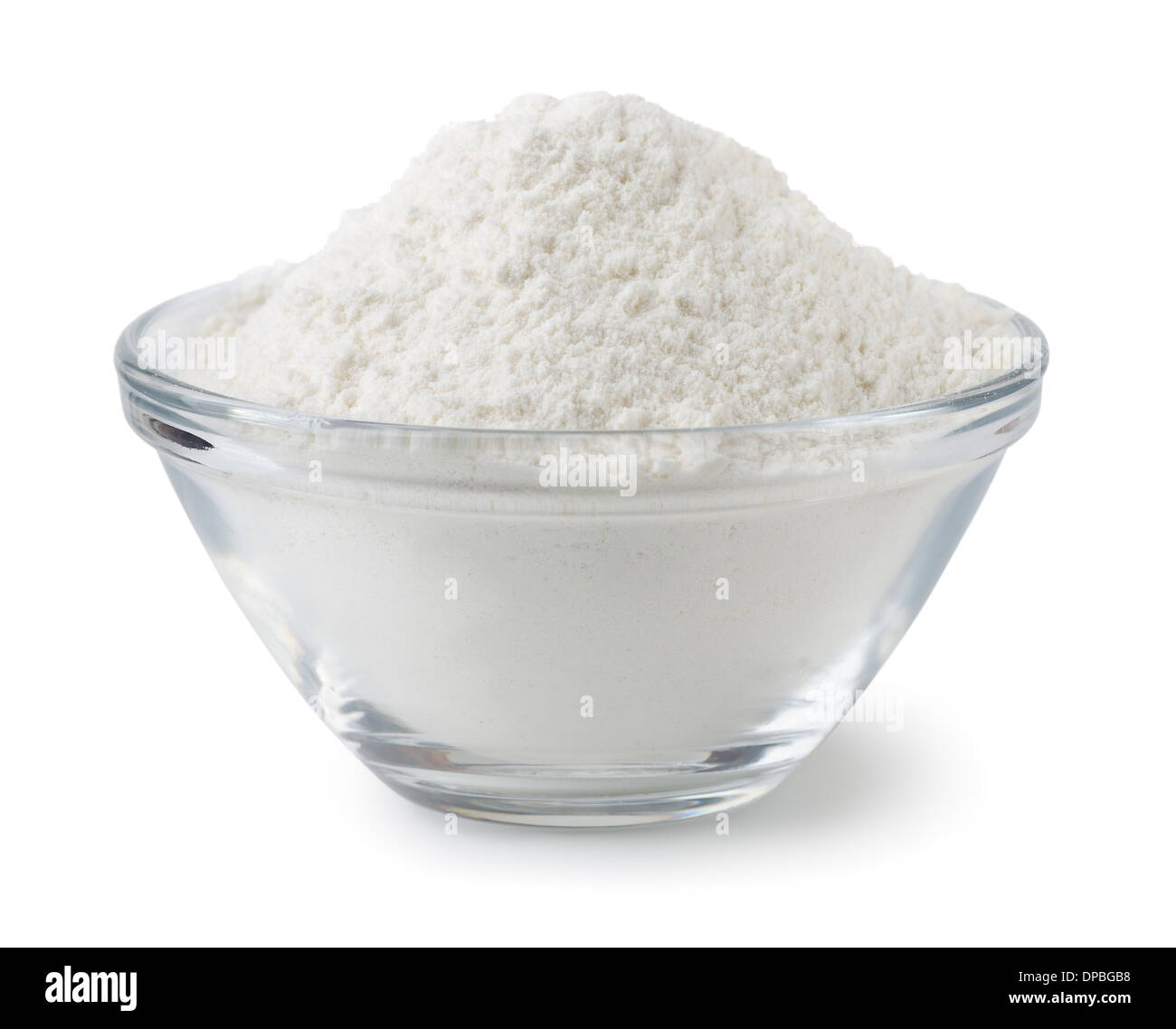 Glass bowl of wheat flour isolated on white - Stock Image