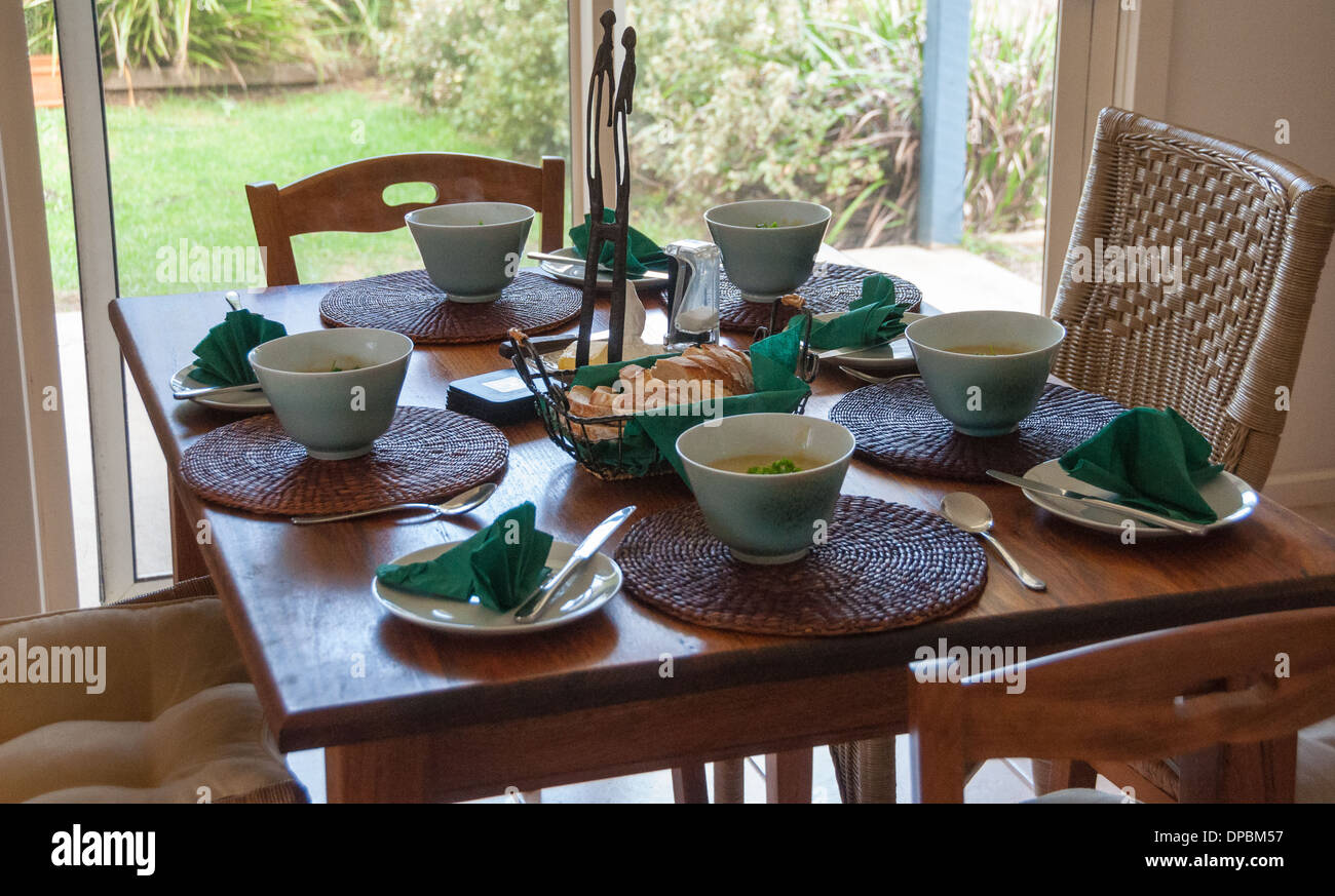 Dining table set for dinner with soup bowls in a house 5 place setting & Dining table set for dinner with soup bowls in a house 5 place Stock ...