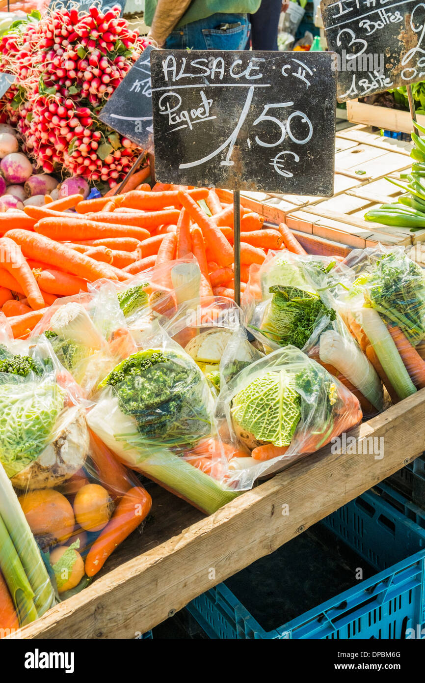 alsatian radishes, carrots and cabbages for sale at an outdoor market, mulhouse, alsace, france Stock Photo