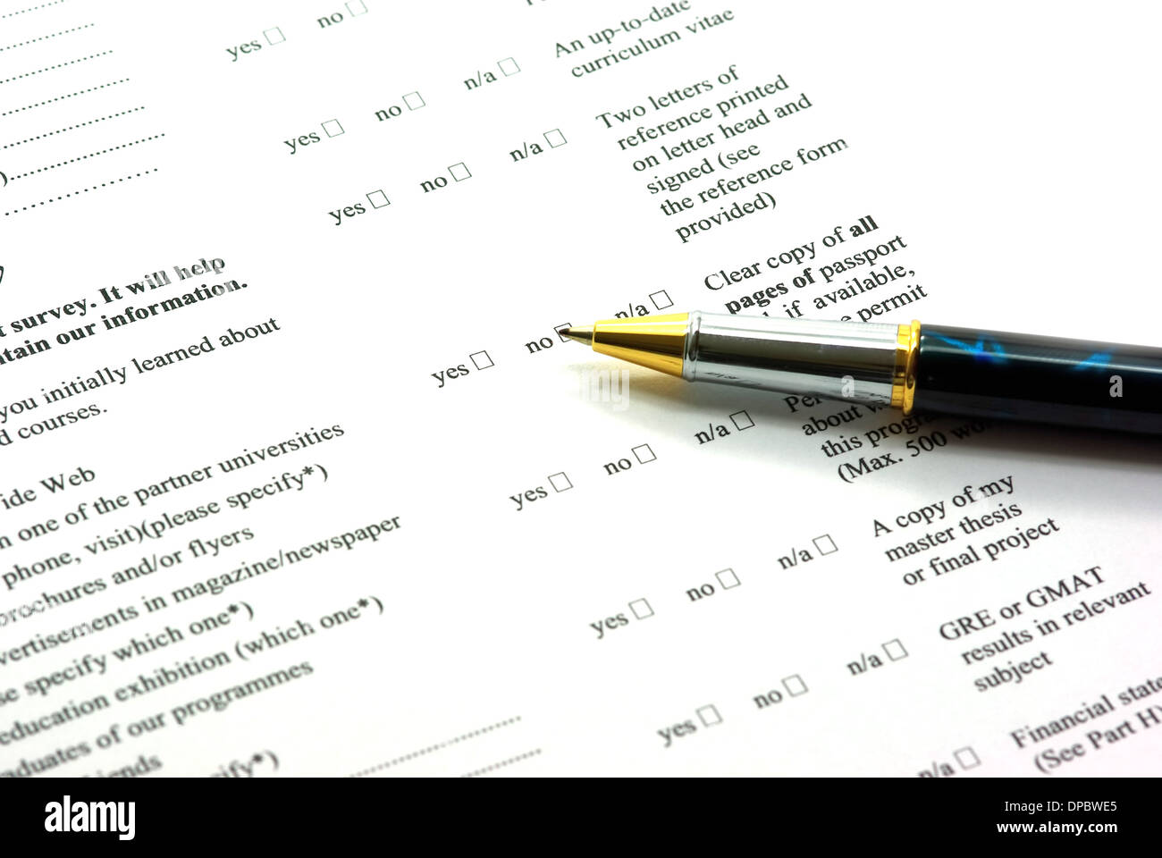 Completing application form with pen in education Stock Photo