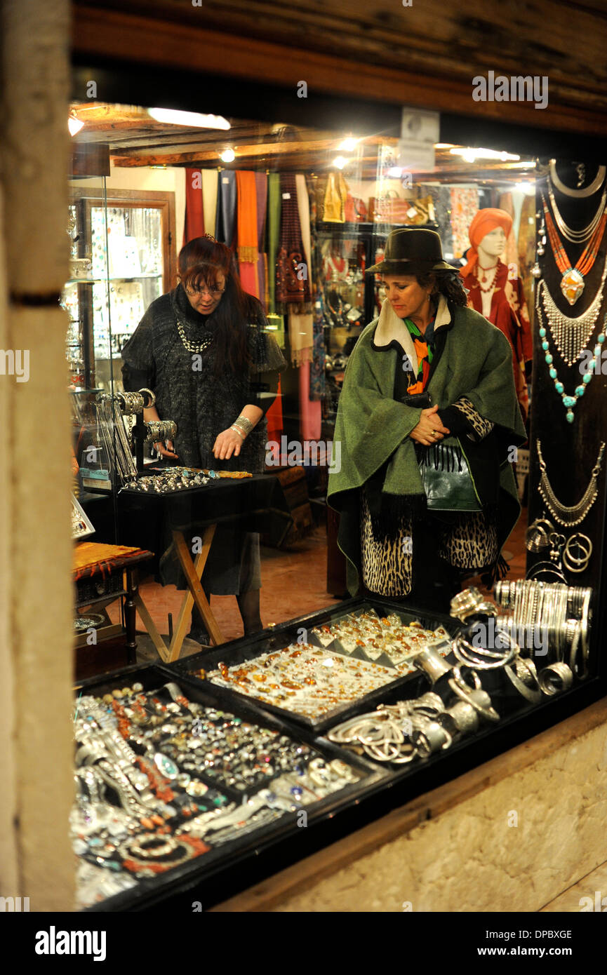 Woman shops for antiques in Venice Italy - Stock Image