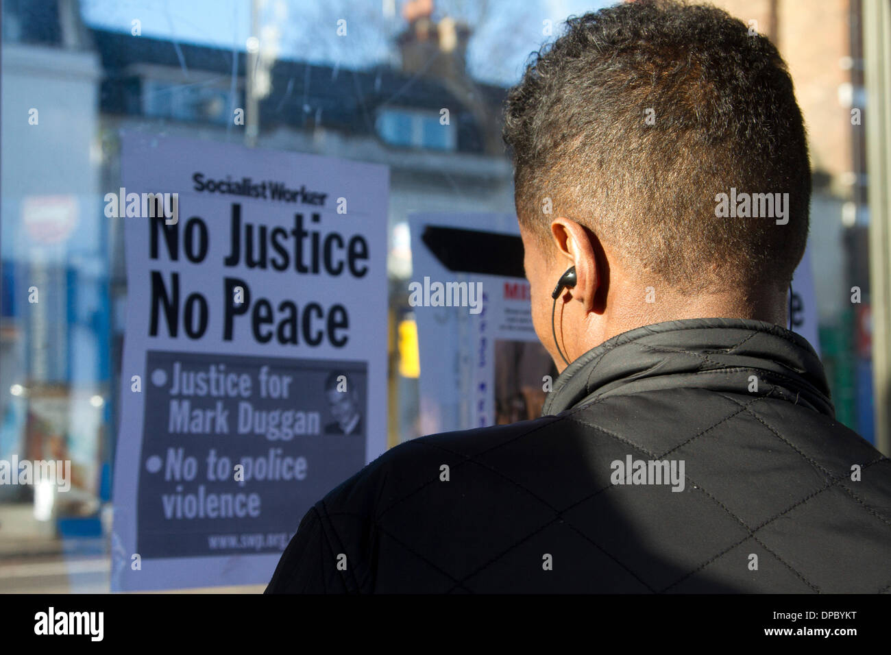 Tottenham London UK. 11th January 2014. Family and relatives of Mark Duggan were joined by hundreds of supporters outside Tottenham police station to fight for justice after an inquest  verdict found Mark Duggan was lawfully killed by police when he was shot in August 2011 - Stock Image
