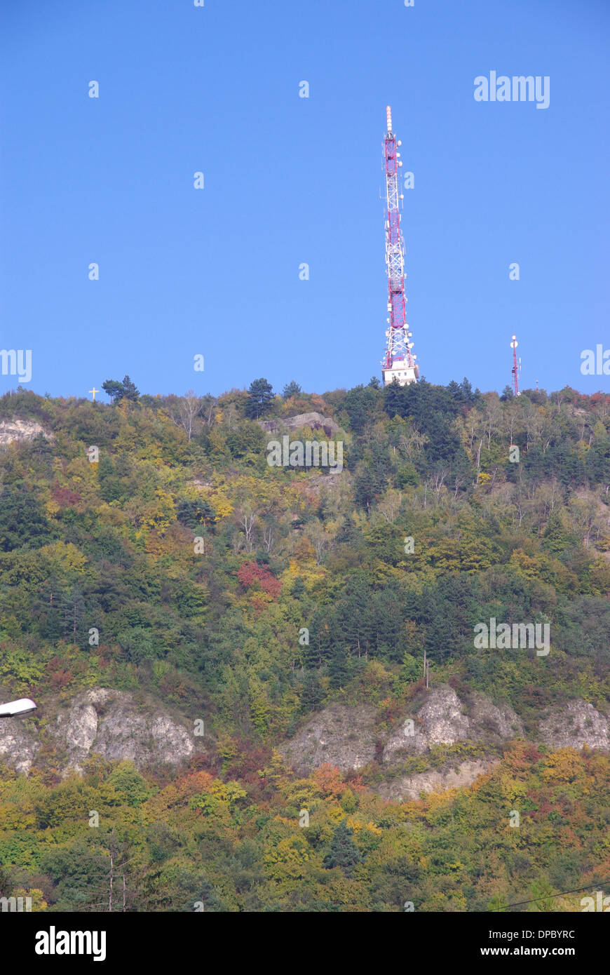 Forest in autumn on a hill with a TV tower up. Stock Photo