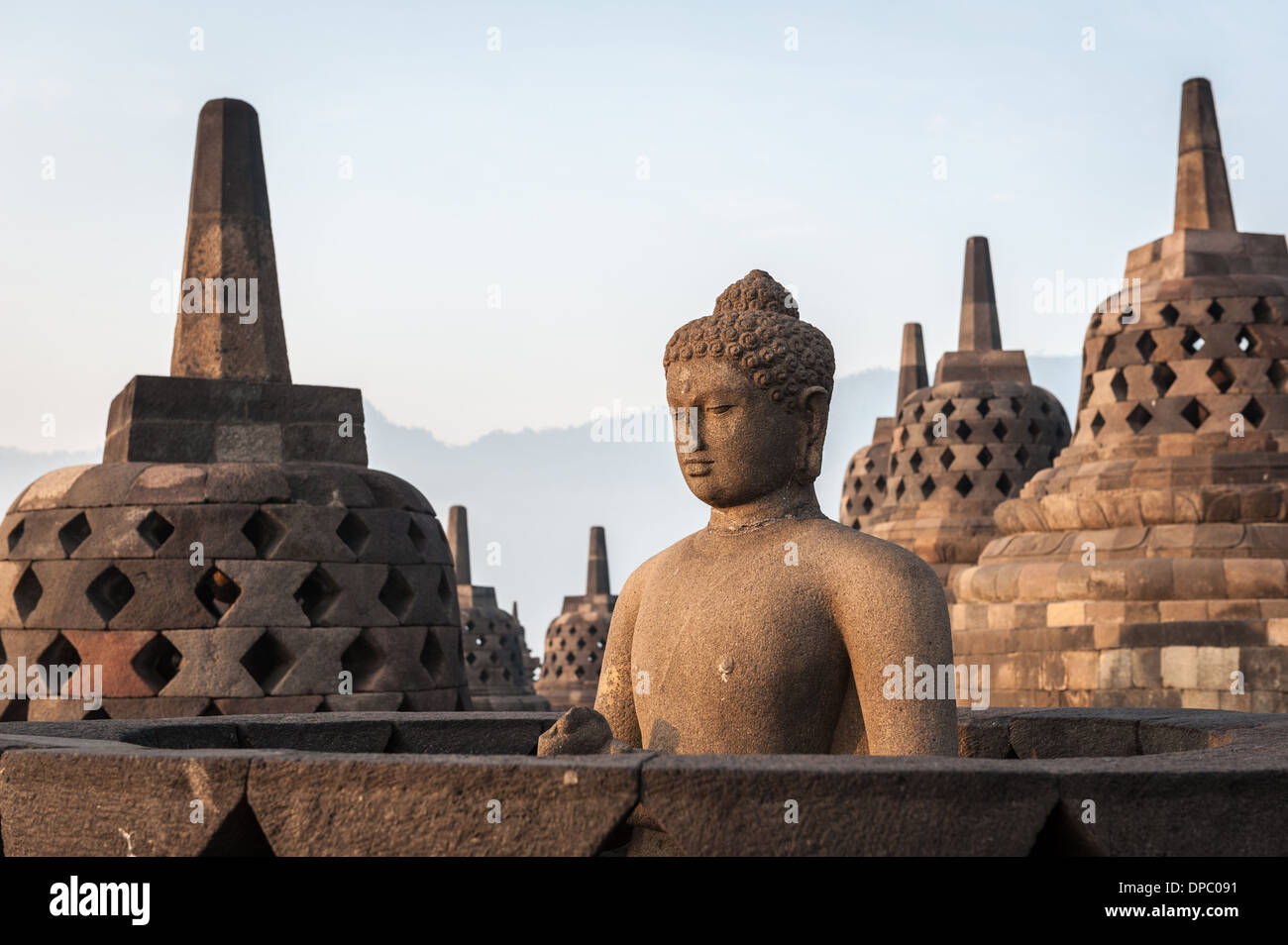 Sunrising over the stupas of the Buddhist temple of Borobudur, Java, Indonesia. - Stock Image